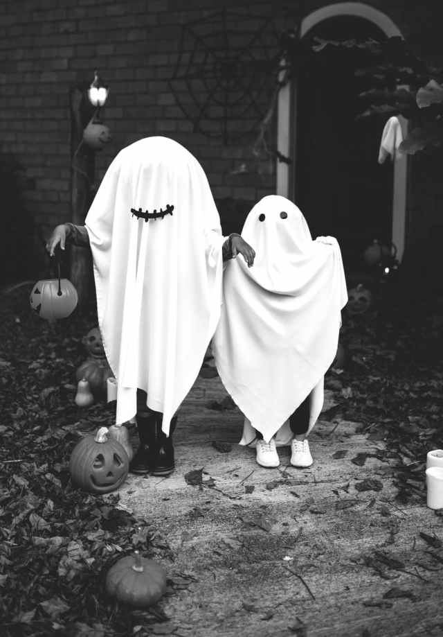 two people dressed as ghost